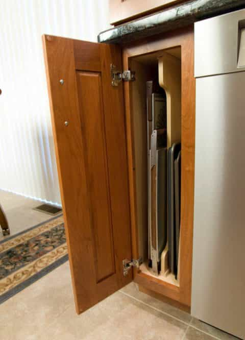Specialty cabinetry for storing baking sheets and cutting boards