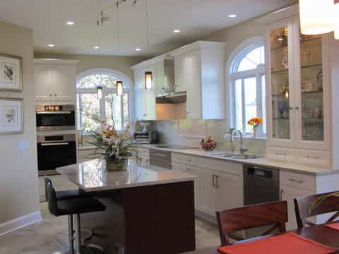 A uniquely shaped island gives a more contemporary feel to this Pennington, NJ kitchen design