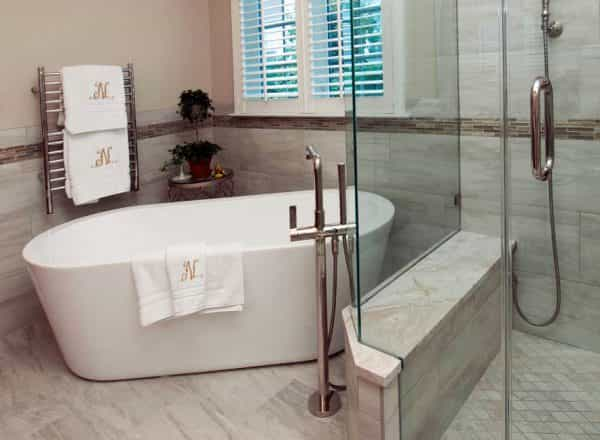 A transitional bathroom design with a free-standing tub in a Washington Crossing, PA home