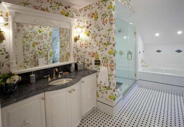 Colorful wallpaper and a unique countertop bring color to this traditional bathroom design in Newtown, PA