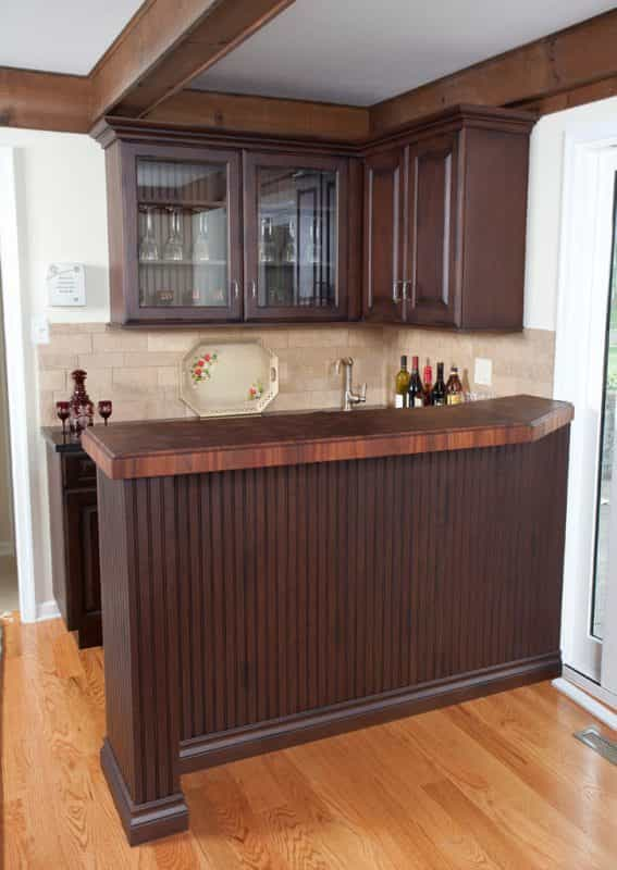 A Grothouse wood countertop completes the look of this Yardley, PA home's bar.