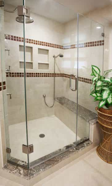 Hand held shower heads and shower benches are two sylish - and utilitarian - ways to upgrade your bathroom, as seen in this home in Yardley, PA bathroom design