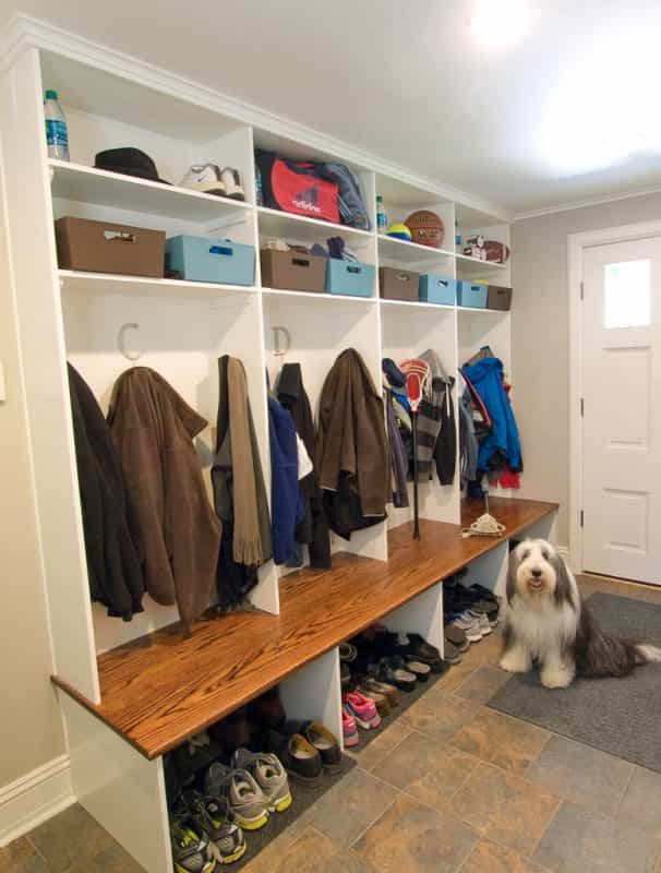 The mud room of this Princeton, NJ home keeps coats, shoes, and sports equipment neat.