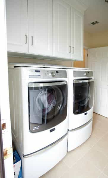 The laundry room in this Washington Crossing, PA home keeps linens and washing supplies out of sight.